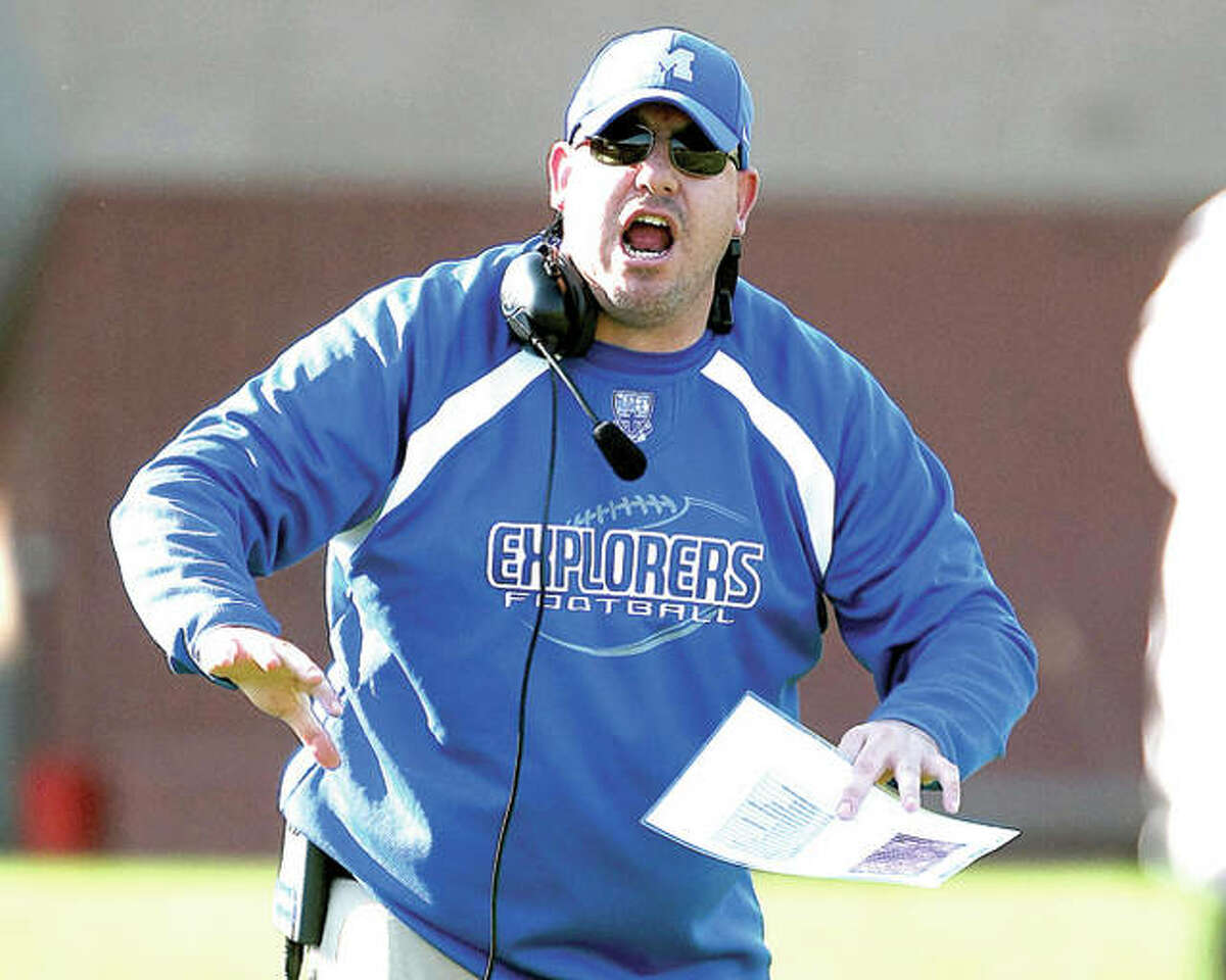 Tim Nelson, during his days as head football coach at Marquette Catholic High, shouts during Class 3A Playoff game against North Mac.