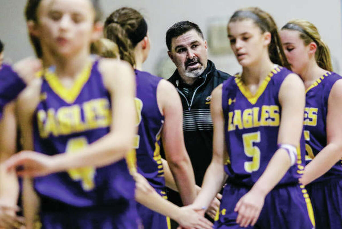 CM coach Jonathan Denney (center, back) watches Hannah Schmidt (6) and his Eagles come back to the bench earlier this season during a win at the Jersey Holiday Tournament. After moving up to No. 3 in the Class 3A state poll earlier in the day, the 20-2 Eagles suffered their second loss of the season Wednesday night, falling to Breese Central in the semifinals of the Highland Tourney.