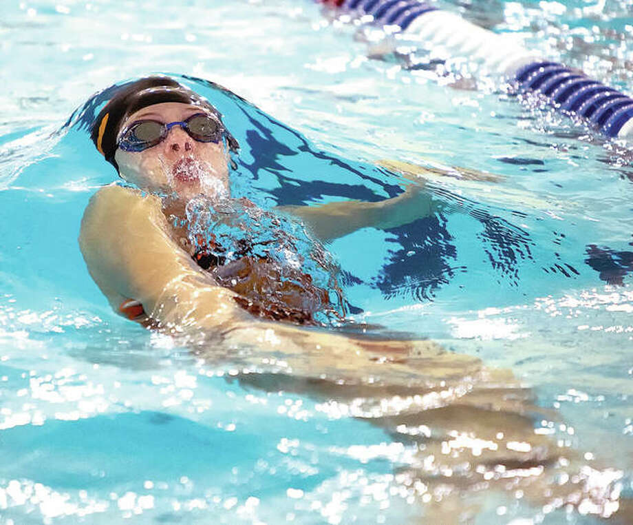 Phoebe Gremaud of the Edwardsville YMCA Breakers became the team's fifth swimmer with a YMCA national qualifying time when she swam a national cut in the 100-yard backstroke at the Martin Luther King Invite at the Chuck Fruit Aquatic Center. Photo: Scott Kane | For The Telegraph