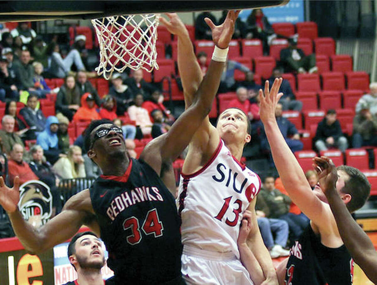 Southeast Missouri State's Denzel Mahoney (34) battles with SIUE's Christian Ellis in action Thursday night at the Vadalabene Center. Mahoney scored 36 points to lead SEMO to an 86-74 victory.
