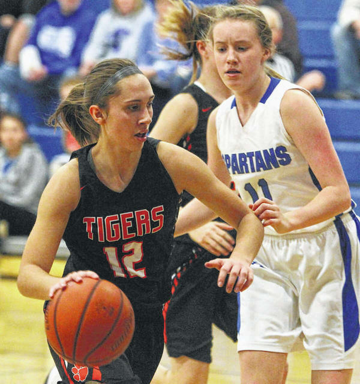 Greenfield's Kassidy Walters (left), shown in a game last season against North Greene in White Hall, scored 34 points Thursday in a Senior Night victory over Calhoun in Greenfield.
