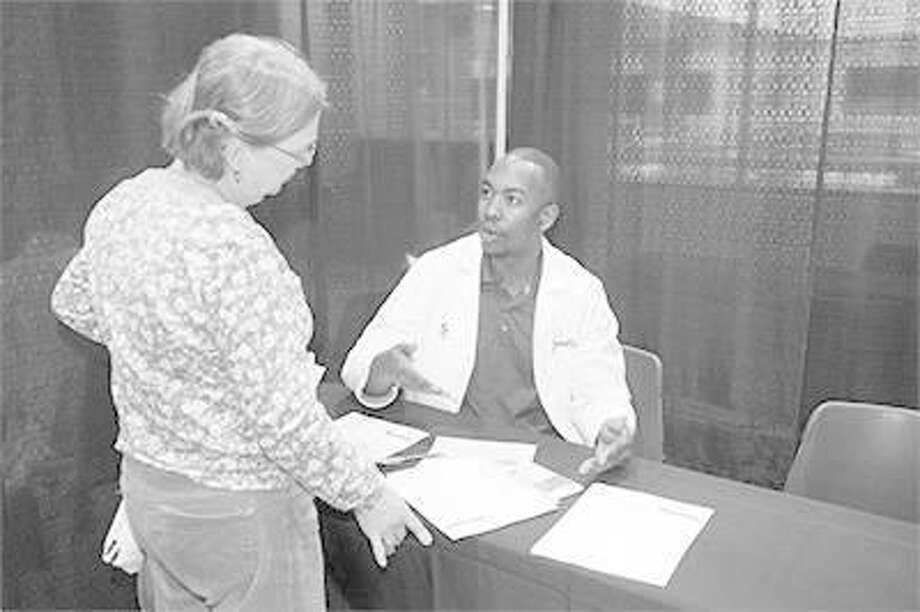 School of Pharmacy student Jamal Sims visits with Cheryl from Highland at SIUE's 11th annual Free Diabetes Education Program.