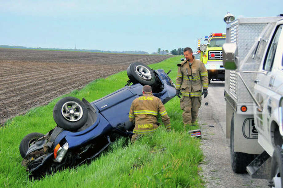Ashland firefighters, MECCA emergency personnel and Cass County sheriff's deputies respond to a rollover accident on Newmansville Blacktop early Saturday. Details about the accident were unavailable Saturday afternoon. Photo: Robert Daniel | Journal-Courier