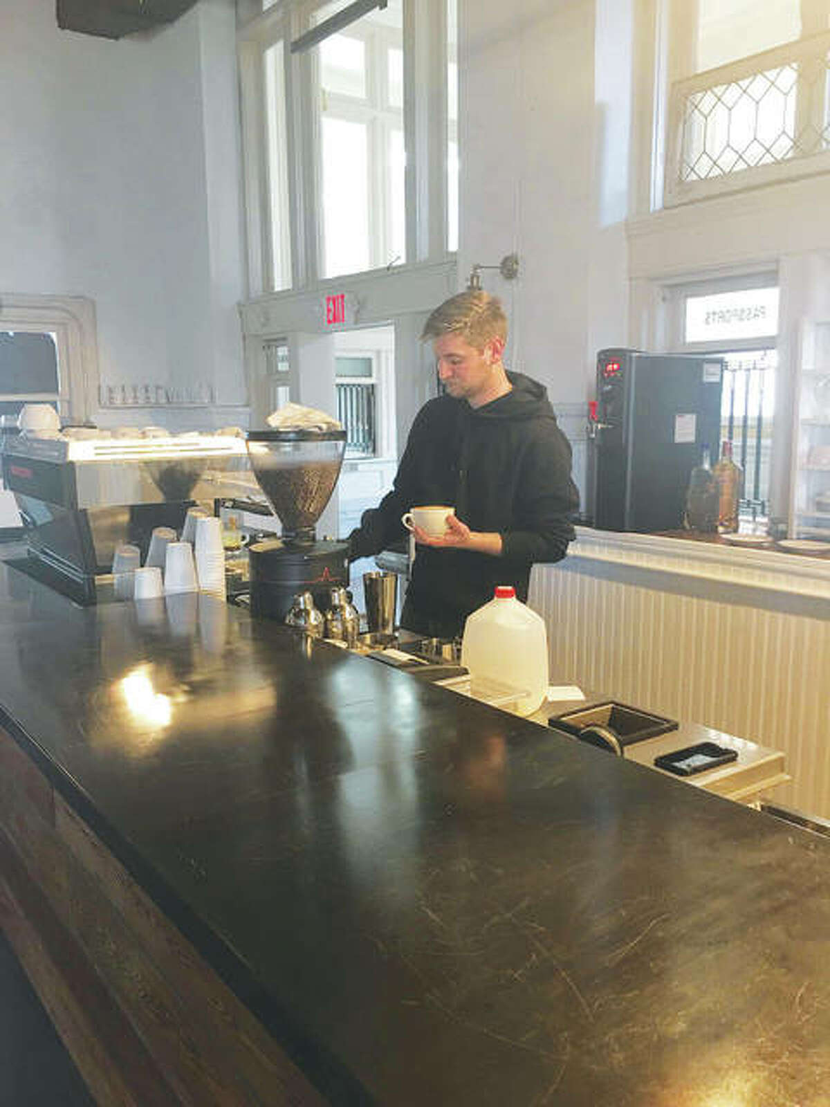 Barista David McCann prepares a latte, topping it with a perfectly-executed design. McCann moved to Alton five months ago, along with his sister, Justine McCann, as part of Post Commons' team of like-minded individuals who share owner Hugh Halter's vision for the private-public entity.