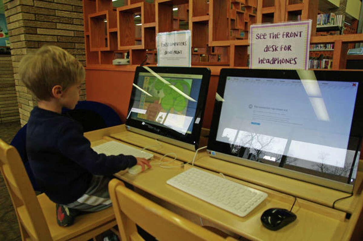 Milo Lux uses the special Kids in Focus search engine at the Wood River Public Library. Catering to children who are increasingly raised with smartphones and computers is just one of the ways libraries are staying relevant in an ever-changing world.
