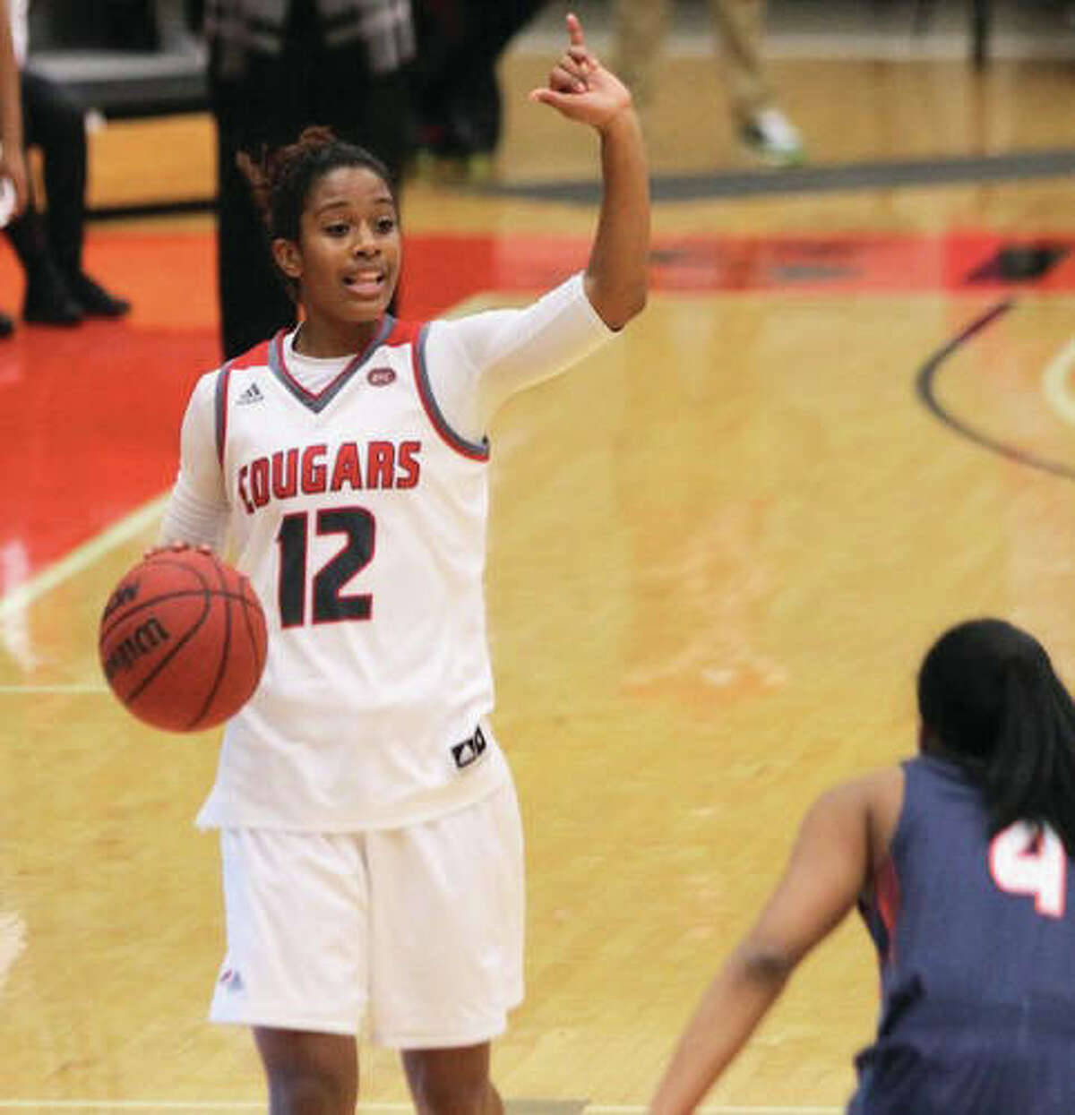 SIUE's Lauren White (12), a senior from Edwardsville, hit a 3-pointer at the buzzer to give the Cougars a OVC victory over UT Martin on Saturday night at Vadalabene Center in Edwardsville. White finished with a game-high 20 points and a career-high seven assists.