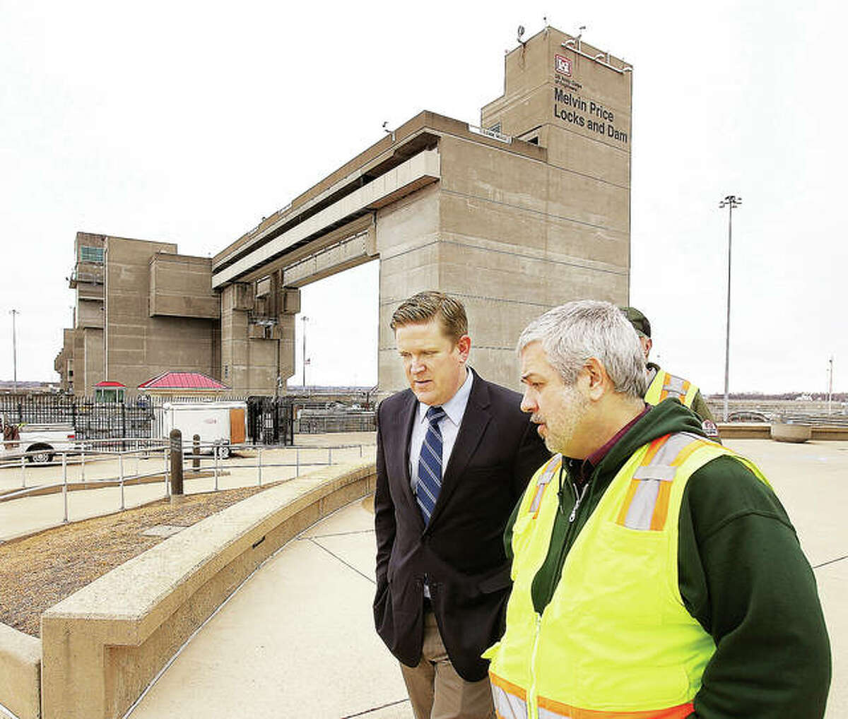 St. Clair County State's Attorney Brendan Kelly, left, talks with Andy Schimpf, right, operations manager for the Mississippi River Project, Tuesday during a tour of the Melvin Price Locks and Dam 26 in Alton. Kelly is running against David Bequette in the primary for the Democratic nomination, as a candidate for U.S. Representative for Illinois' 12th Congressional District. Republican Mike Bost currently holds the U.S. Representative seat, but has a challenger in the primary.