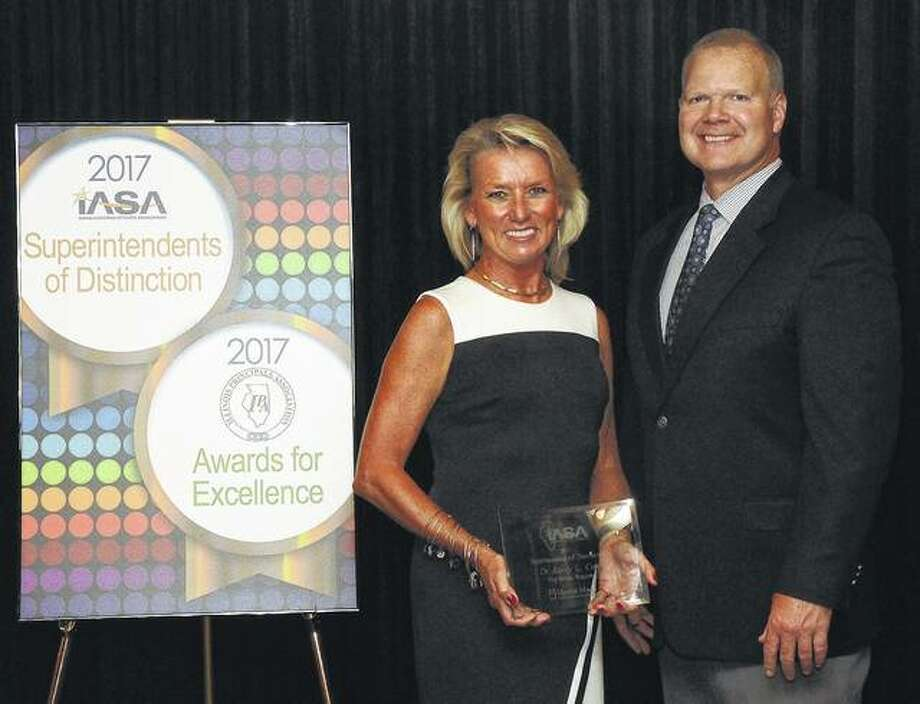 Photo provided Carrollton schools Superintendent Kerry L. Cox is presented with recognition as the 2017 Superintendent of Distinction.