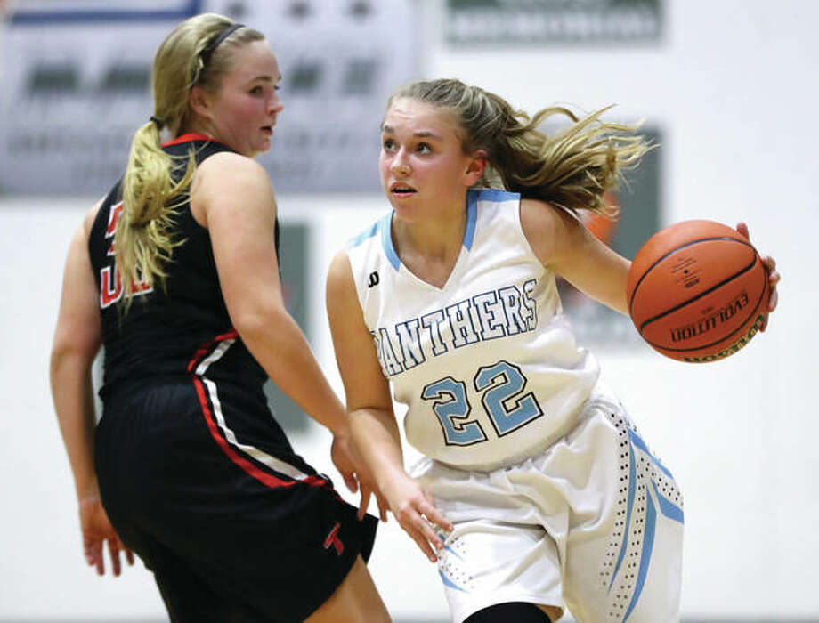 Jersey's Clare Breden (right), shown driving the lane past Triad's Ali Barisch during a Dec. 14 game at Havens Gym in Jerseyville, and her Panthers teammates were in Carrollton on Tuesday night for a tournament quarterfinal game against Quincy Notre Dame. Breden scored 16 points in the loss to QND. Photo: Billy Hurst / For The Telegraph