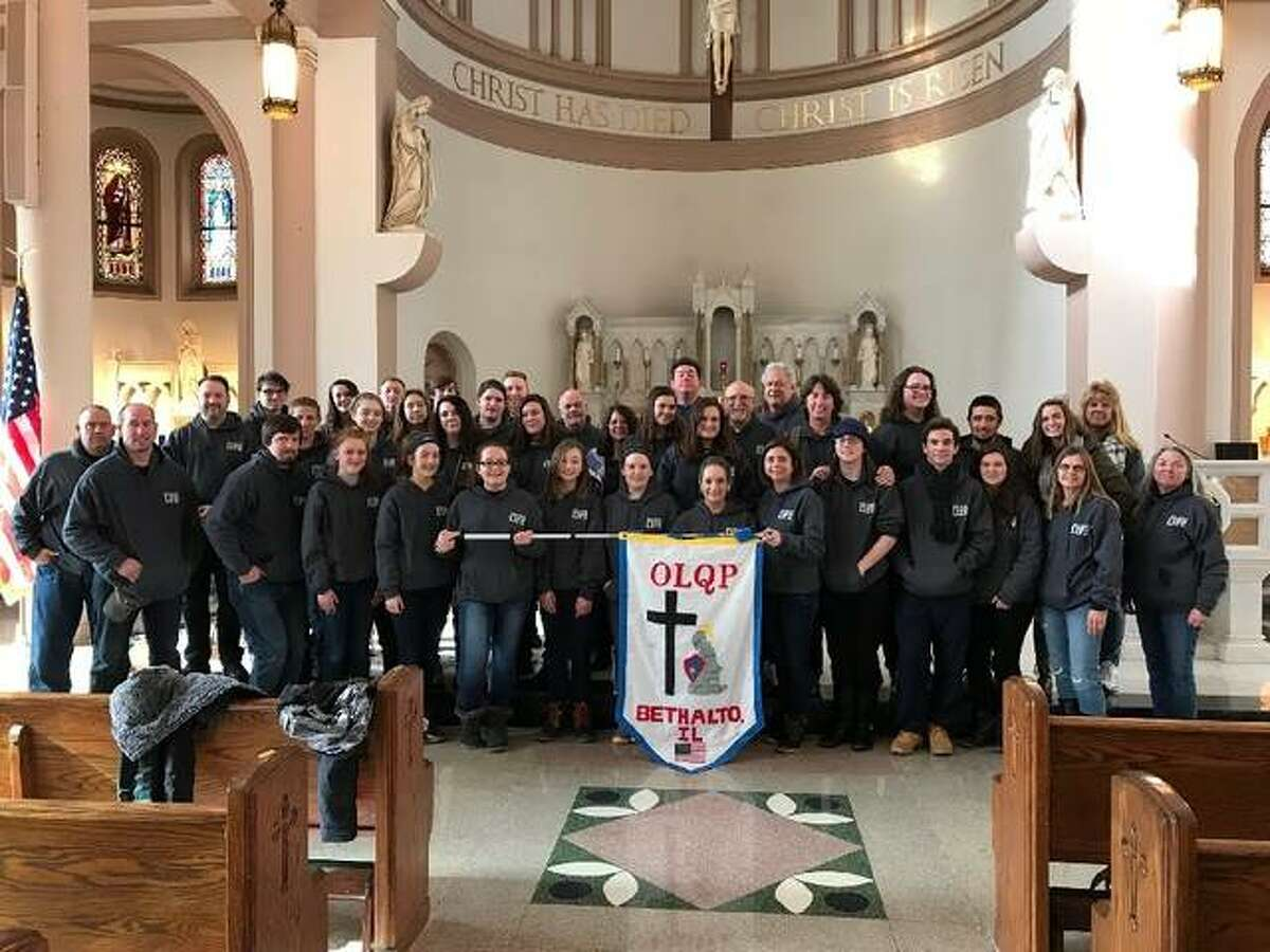 Students and chaperones from Our Lady Queen of Peace Catholic Church in Bethalto pose at a Washington D.C. church for a quick photo.