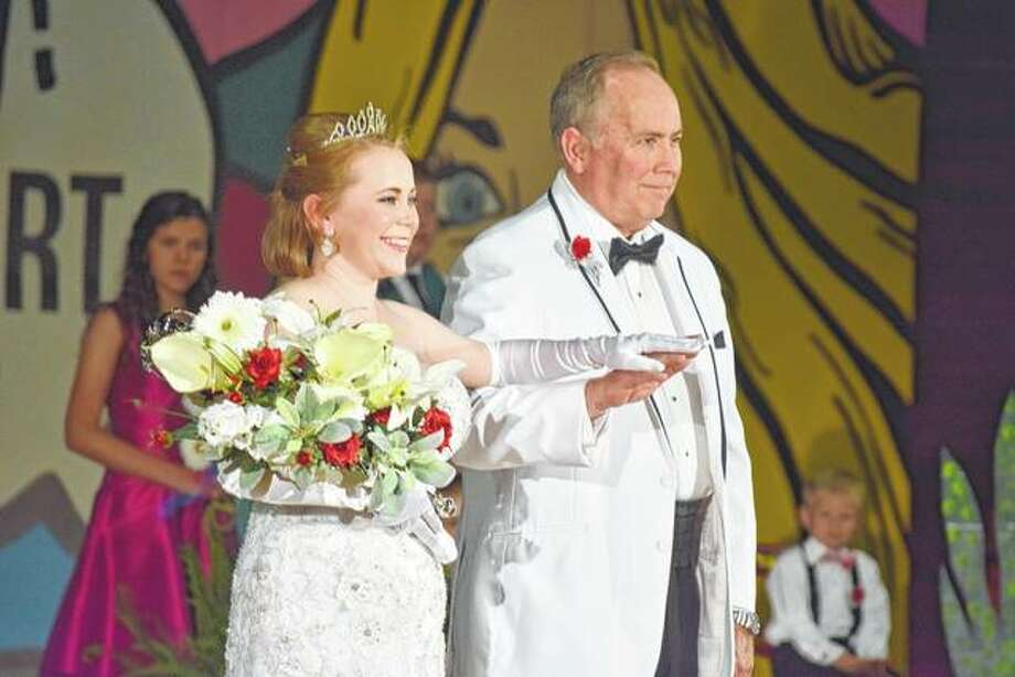 The 2017 queen of the Beaux Arts Ball, Katherine Spencer Hackett, is escorted by her father after being introduced as queen Saturday night at the Jacksonville High School Bowl. She is the daughter of Steve and Cathy Hackett of Jacksonville. Photo: Greg Olson | Journal-Courier