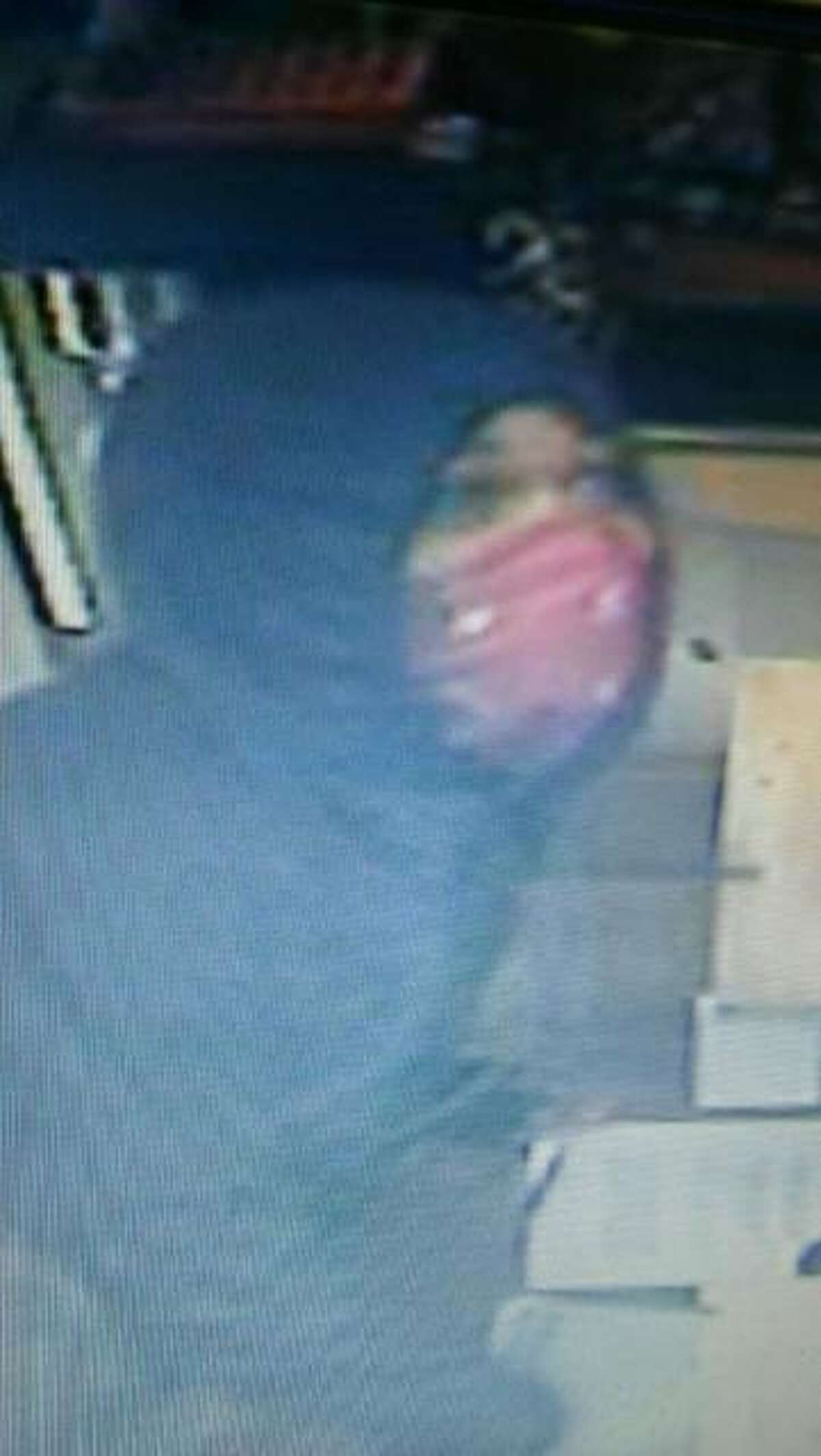Photos of the alleged burglar inside Schwegel's, a family-owned business in Alton.