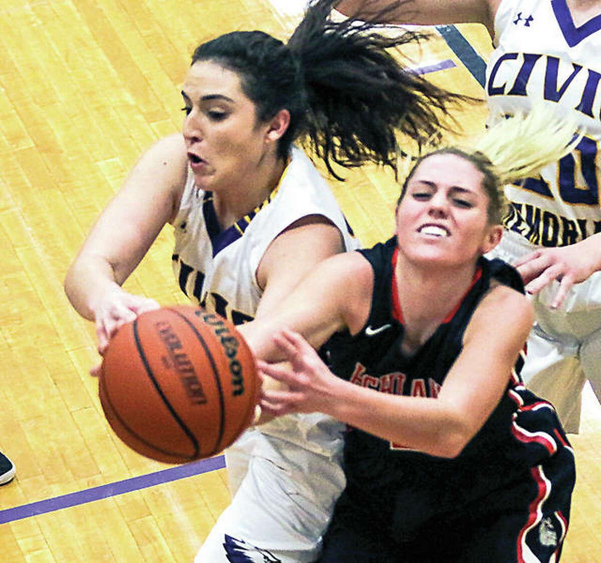 CM's Kaylee Eaton (24) battles Highland's Rece Portell (2) for rebound during Wednesday night's game in Bethalto.
