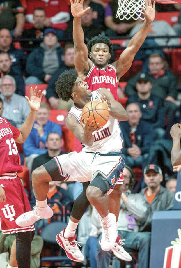 Illinois forward Kipper Nichols looks for a shot against Indiana forward Freddie McSwain Jr. Wednesday night's game in Champaign. Photo: AP