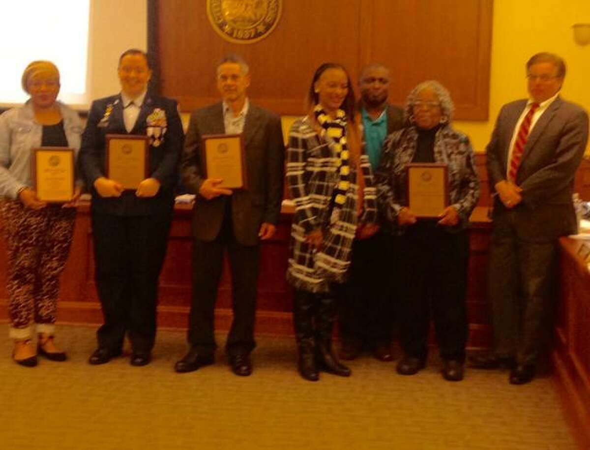 """Mayor Brant Walker honored individuals and a business that the Alton Community Relations Commission selected for the """"Altonians of the Year"""" awards at Wednesday's City Council meeting. From left to right: Leah Becoat, Karissa Mucket, Tim Matifes; Ericka Johnson, Eddie Curry and Sheila Curry - owners of Granny's Uniforms, Work Fashions & More; and Walker."""