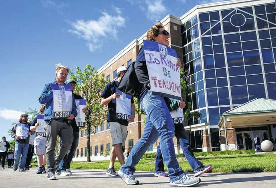 Members of the University of Illinois Springfield United Faculty, the union that represents 186 instructors at UIS, walked a picket line on the campus Tuesday. The union, which has been working since October 2015 on its first contract with the university, announced Monday that it would strike. Photo: Rich Saal   The State Journal-Register Via AP
