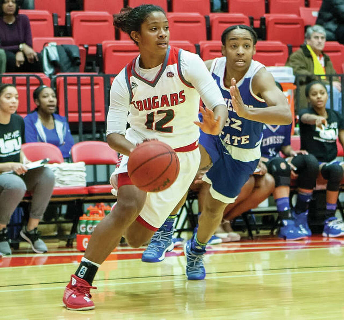 SIUE's Lauren White (left), shown driving past a Tennessee State defender during a Jan. 13 game at Vadalabene Center in Edwardsville, was one of three Cougars scoring in double figures Thursday in Nashville. The Cougars won to sweep their two OVC dates with Tennessee State.