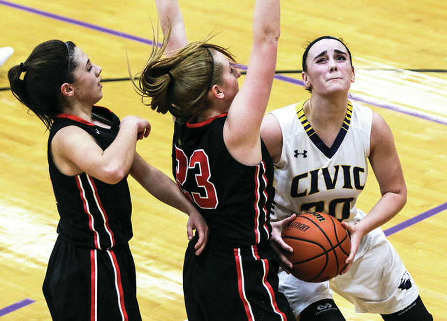 Civic Memorial's Anna Hall (right) looks to the basket while Highland's Lauren Baer (middle) and Ellie Brown defend during CM's Mississippi Valley Conference game Wednesday night in Bethalto. On Thursday night, Hall had 15 points and 15 rebounds to lead CM to a victory in Columbia. Photo: Nathan Woodside / For The Telegraph