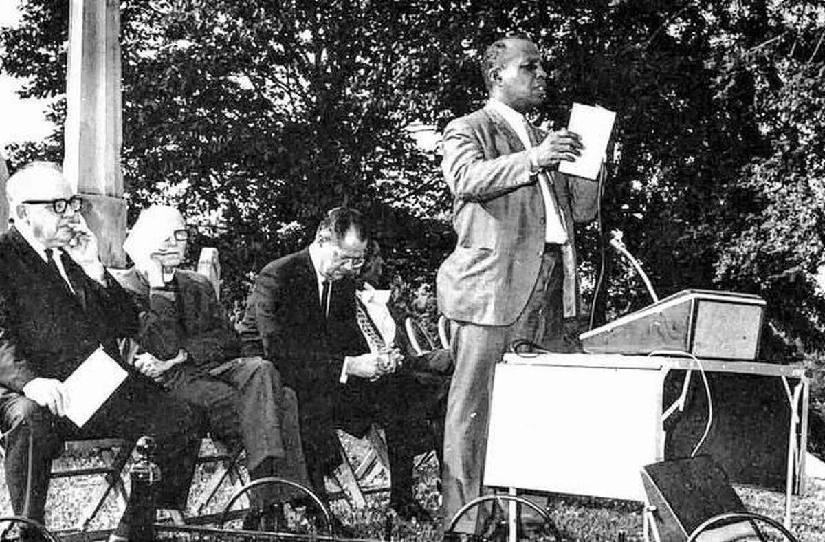 Jesse L. Cannon, founder of the Lovejoy Commission, reads a tribute to the martyr, Elijah P. Lovejoy, at the re-dedication and beautification of the Lovejoy Monument on Sept. 25, 1969, in Alton City Cemetery. Mr. Cannon, an Alton resident, interested many people in joining the commission, which also gives scholarships to students for continuing education, as well as keeping Lovejoy's memory fresh.