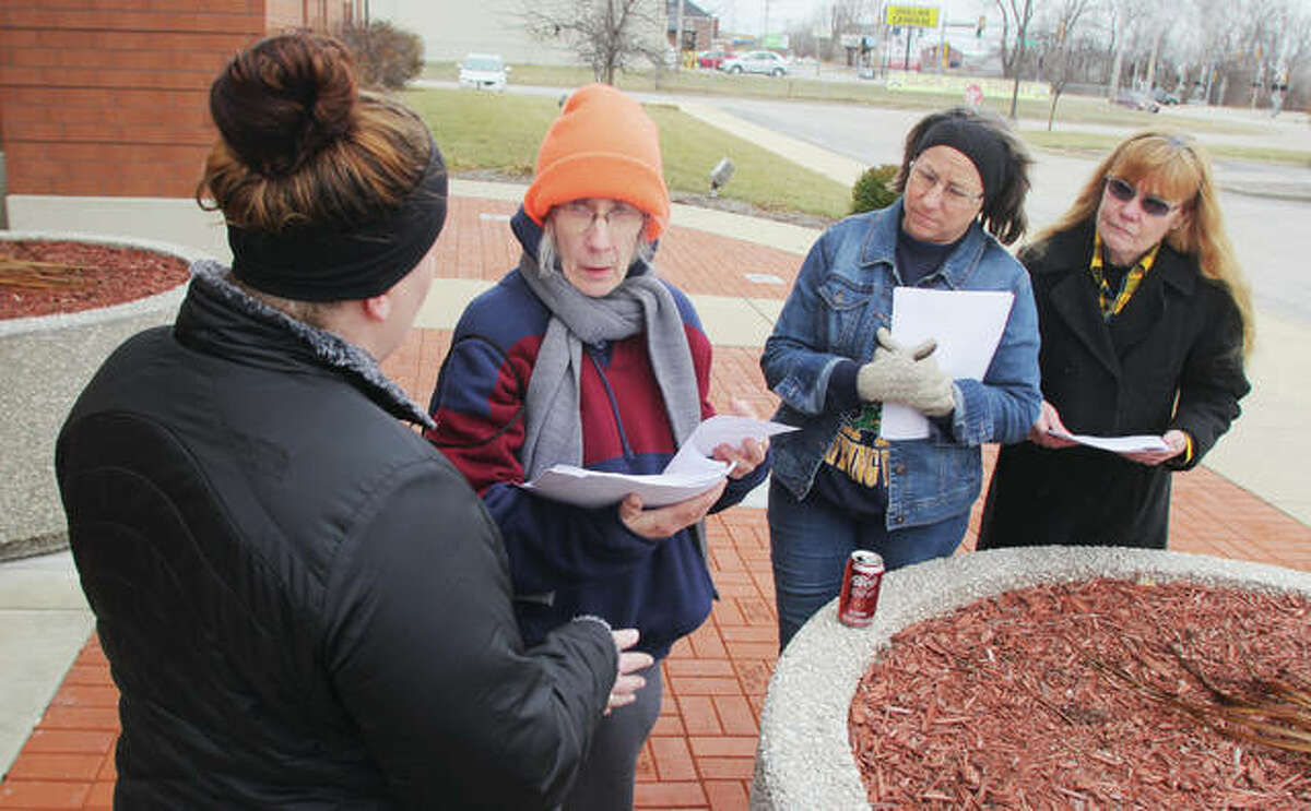 Brittany Pinnon , left, talks to volunteers Diane Martin, JoEllyn Paterson and Martha Rankin after handing out forms for the annual homeless count last year. The group met in front of the Donald E. Sandidge Alton Law Enforcement Center before fanning out. This year's count is set for Monday.