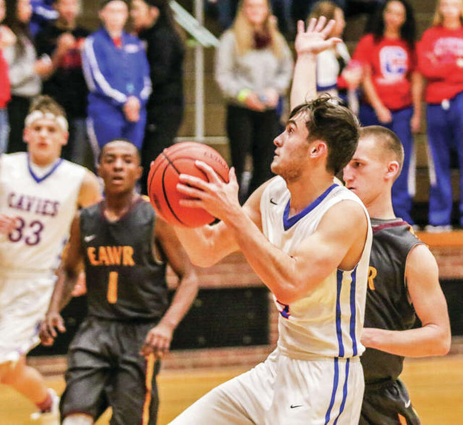 Carlinville's Finn Bowman, front, scored nine points in the Cavies' victory over Roxana Friday night at Larry Milazzo Gym. He is shown in action ealrier this season against EA-WR.