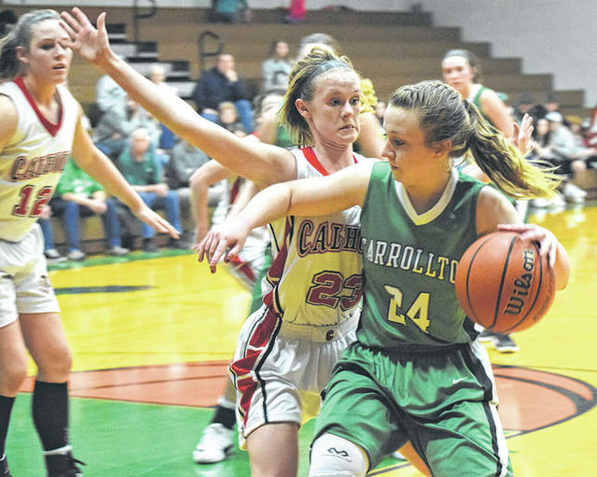 Carrollton's Hannah Krumwiede (24) looks to drive the baseline while Calhoun's Junie Zirkelbach defends during a fifth-place semifinal game Friday night at the Carrollton Tournament.