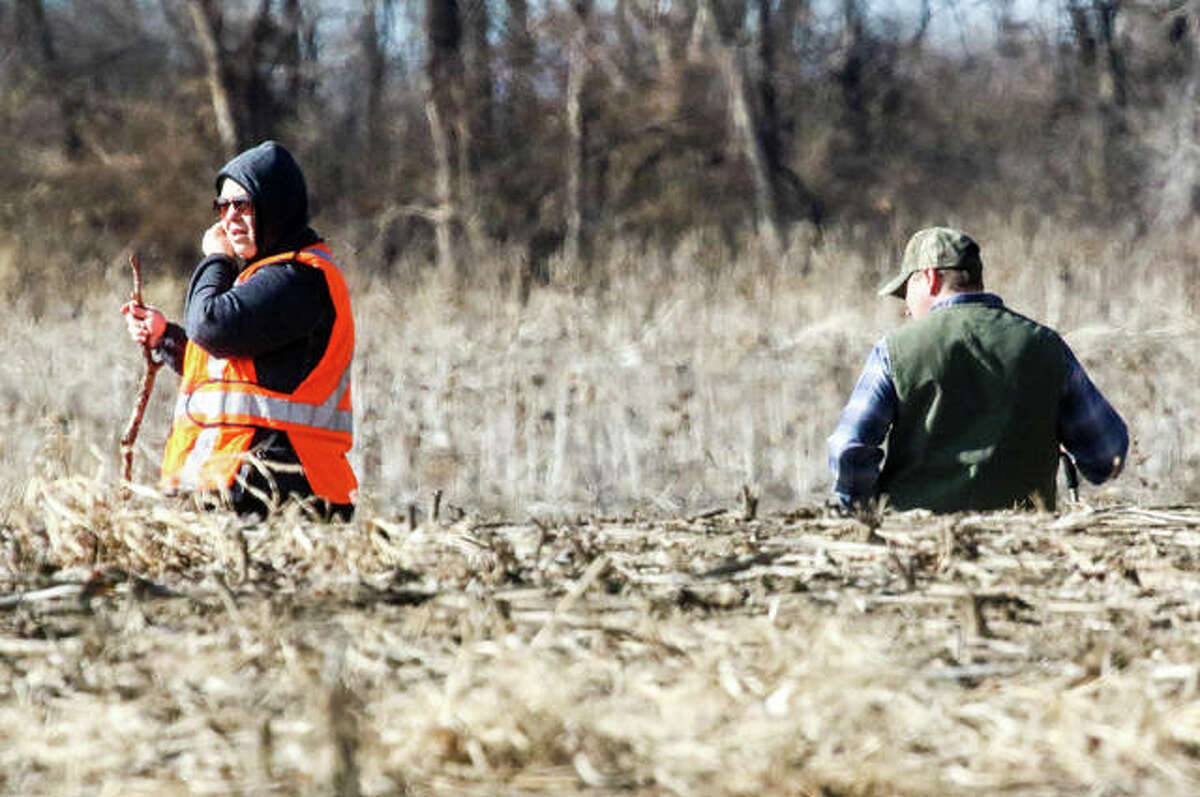 Volunteers Saturday search a low-lying area. The terrain traversed by search parties included thick wood lines, crop fields and tallbrush.