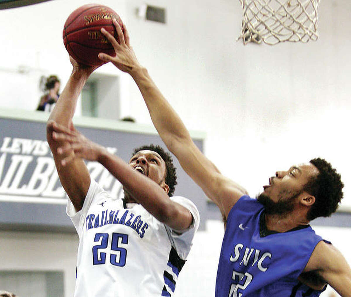 Lewis and Clark's Jehu Lafeuillee's shot is blocked by Jaalam Hill of Southwestern Illinois College Saturday the River Bend Arena in Godfrey. LC lost 125-92.