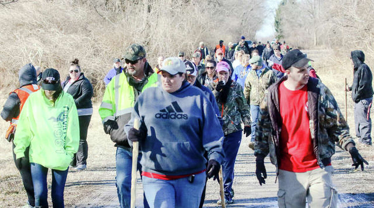 Dozens of volunteers trek to the remote, wooded area where missing Alton woman Adria Hatten's abandoned vehicle was found earlier this week.