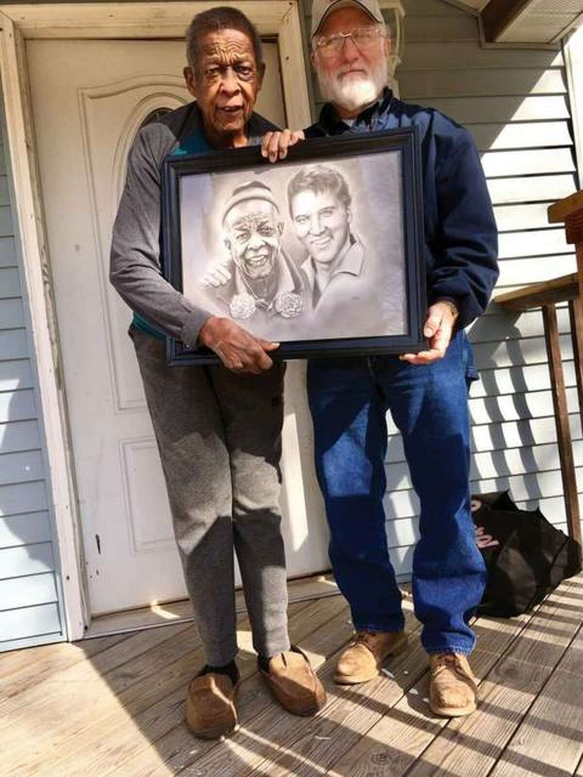 """Marvin """"Preach"""" Webb, left, holds the portrait he was presented by Edwardsville artist Stan Kincaid."""