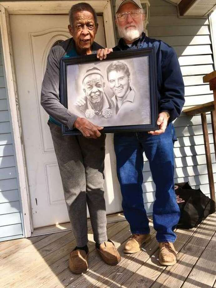 "Marvin ""Preach"" Webb, left, holds the portrait he was presented by Edwardsville artist Stan Kincaid. Photo: Steve Horrell 