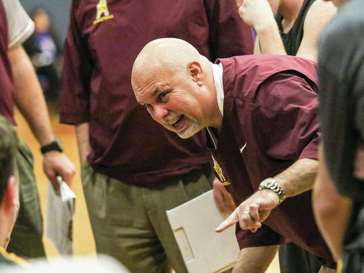 EA-WR coach Ron Twichell instructs his team during a Dec. 2 game at Carlinville. The Oilers are 5-16 in Twichell's first season as coach and have lost eight in a row after Friday's defeat to Marquette Catholic.