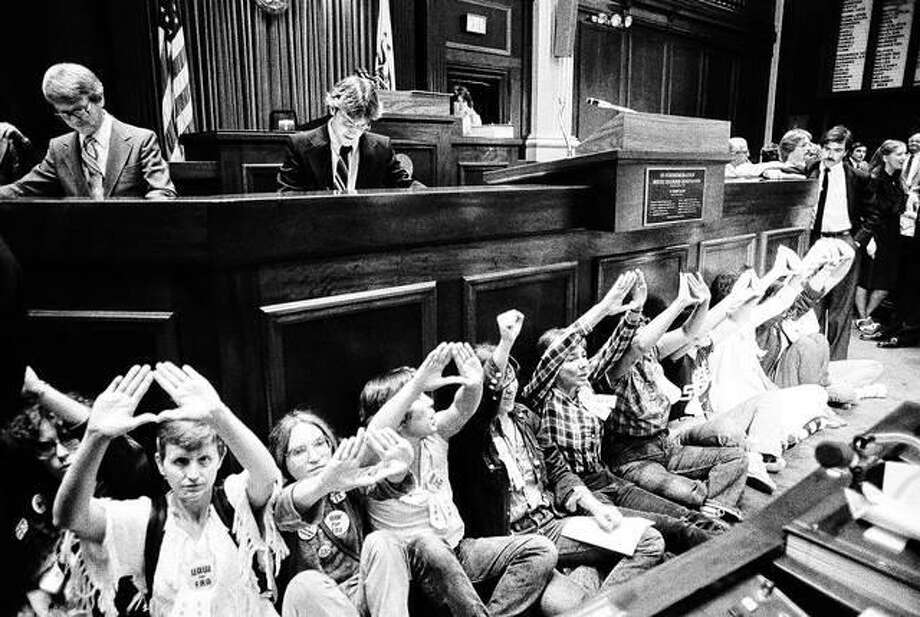 A group of women who had earlier chained themselves to the door of the Senate and blocked the door to the governor's office disrupt the Illinois House sessions in 1982 The Capitol was the scene of high-profile civil disobedience as the clock ticked down on the failed Equal Rights Amendment in 1982. But legal theories suggesting the issue is still alive has supporters pushing for ratification in two more necessary states, and Illinois is back in the spotlight.