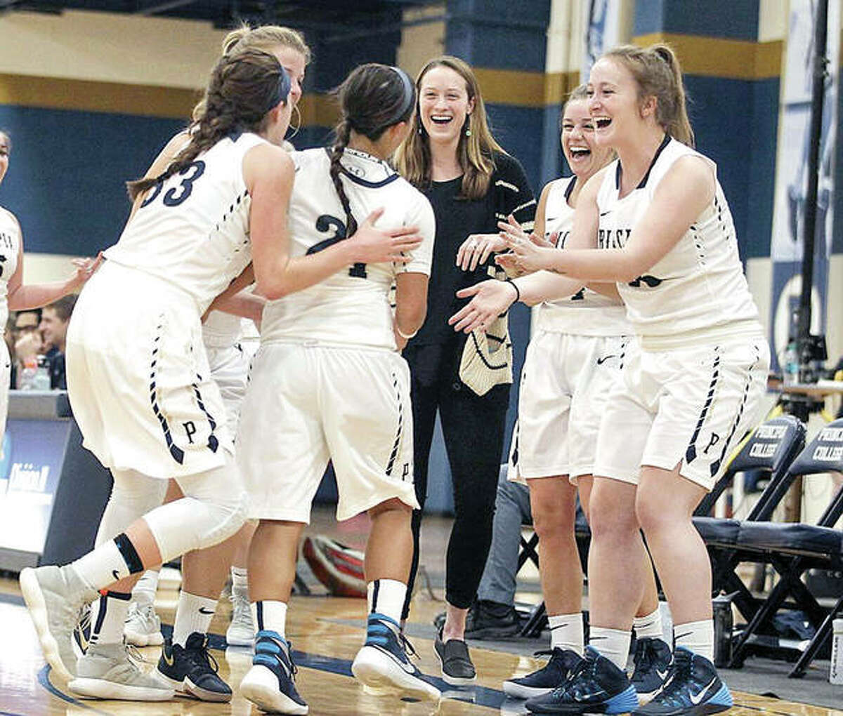 Members of the Principia College junior varsity women's basketball team celenrate during a recent game. Prin has announced that it will bring back varsity women's basketball next season following a two-season absence.