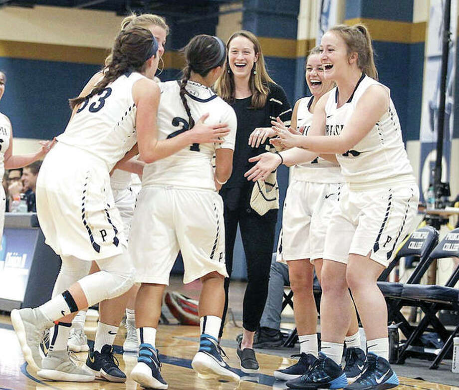 Members of the Principia College junior varsity women's basketball team celenrate during a recent game. Prin has announced that it will bring back varsity women's basketball next season following a two-season absence. Photo: Principia Athletics