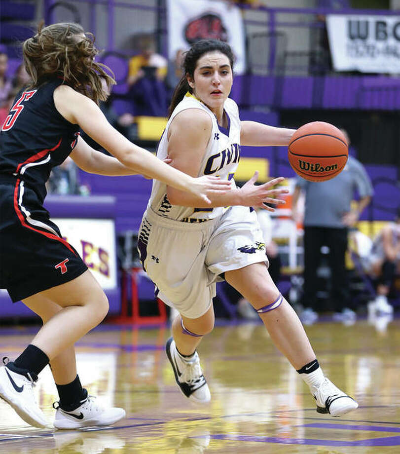 CMs Memorial's Kaylee Eaton (right), scored 14 points in Monday's win over Waterloo. Teammate Tori Standefer also scored 14 points. Eaton is shown in action earlier this season against Triad. Photo: Telegraph File Photo