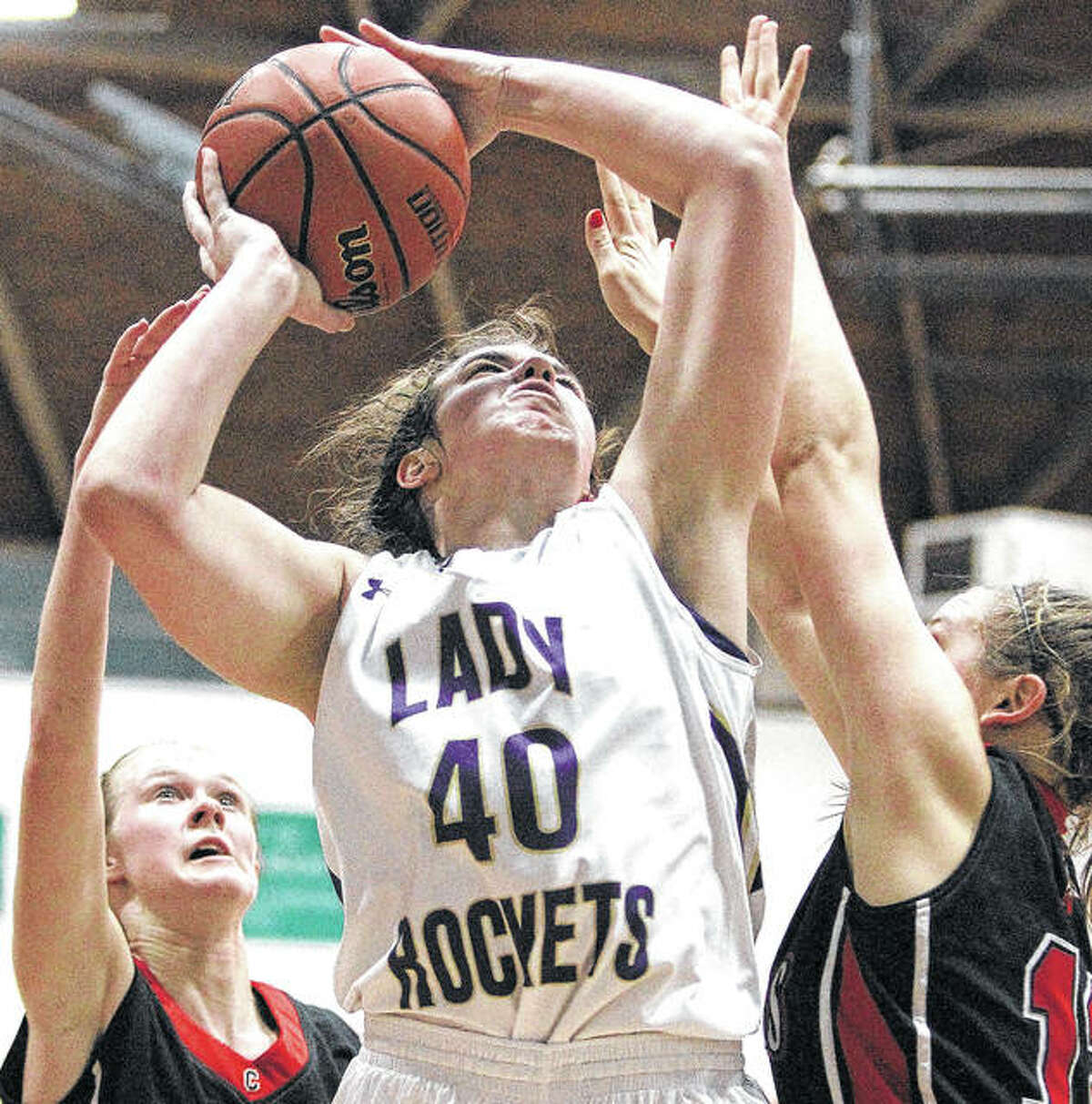 Routt's Katie Abell rises for a shot during a girls' basketball game against Calhoun Monday night at the Routt Dome in Jacksonville.