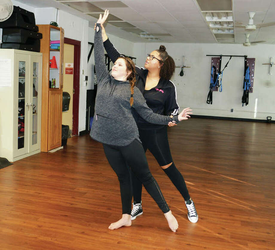 Jennifer Bishop's School of Dance teacher Bailey McCarry, in back, assists student Sophie Bishop, 14, with a pose to arabesque. Bishop, an avid dancer, also teaches jazz to some of the youngest students enrolled at her mother's studio, located at Senior Services Plus in Alton.