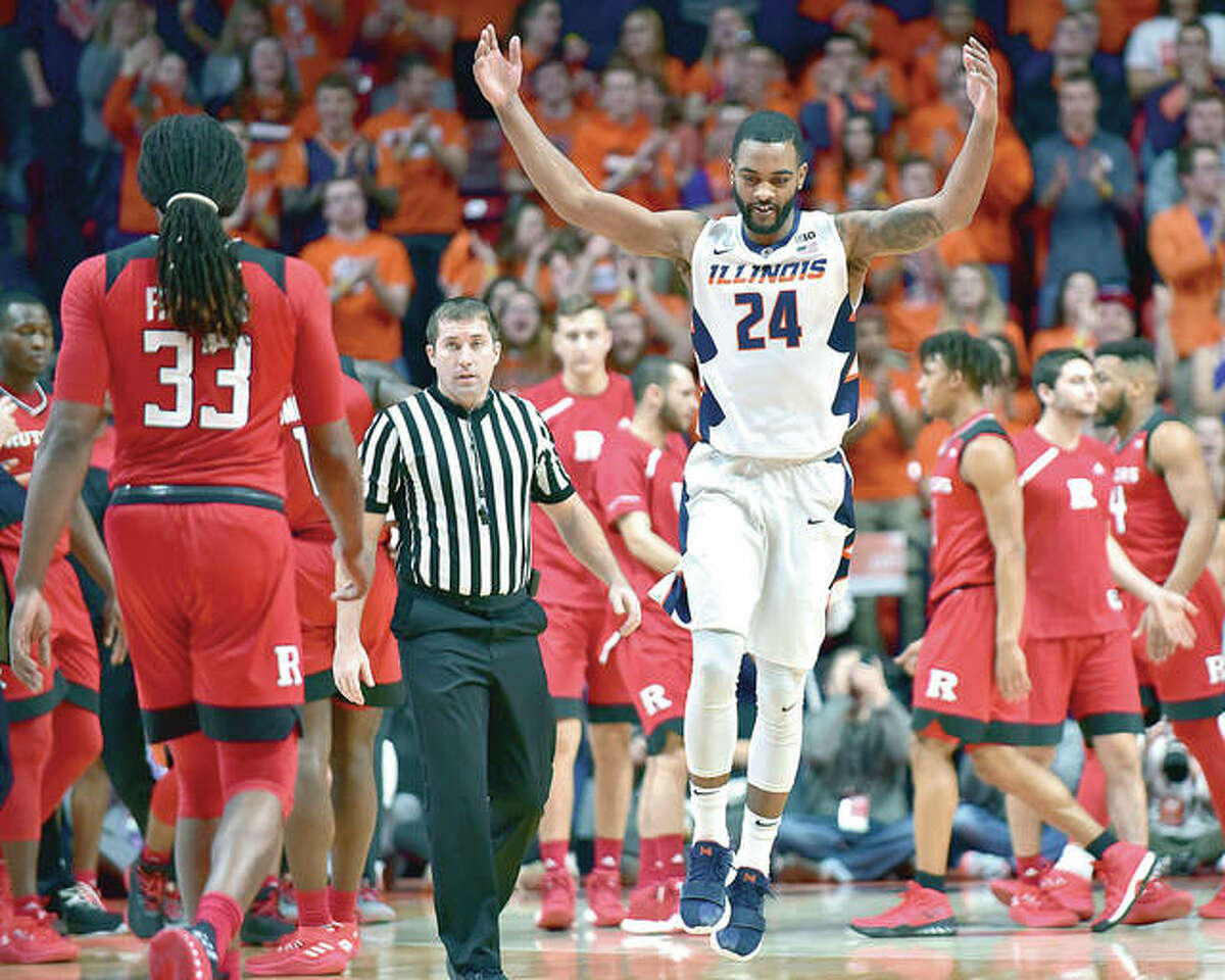 Illinois guard Mark Alstork (24) celebrates after scoring against Rutgers during Tuesday night's game in Champaign. The Illini rolled over the Scarlet Knights 91-60 at State Farm Center.