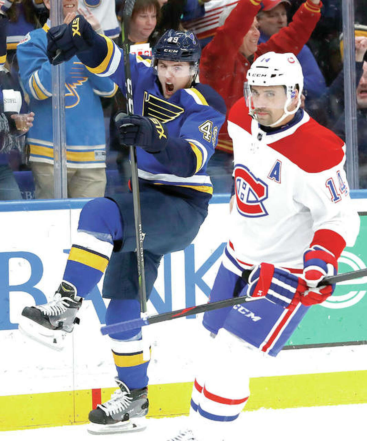 The Blues' Ivan Barbashev, left, celebrates after scoring while the Canadiens' Tomas Plekanec skates past during Tuesday night's game in St. Louis.