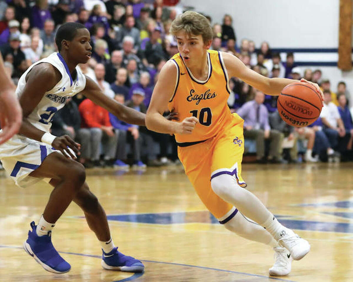Civic Memorial's Bryce Zupan (right), shown driving past Marquette Catholic's Isaiah Ervin during a Nov. 28 game in Alton, scored 14 points Tuesday night at Columbia. CM hits February with a 14-8 record and six games remaining before Class 3A regional play.