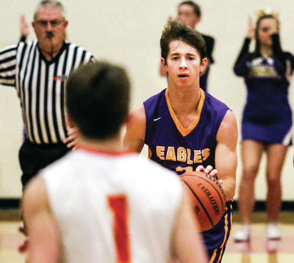 CM senior Caden Clark (right) brings the ball upcourt in a game against the Shells in Roxana on Dec. 15 in Roxana. The Eagles point guard has missed the last two games with a hip injury.