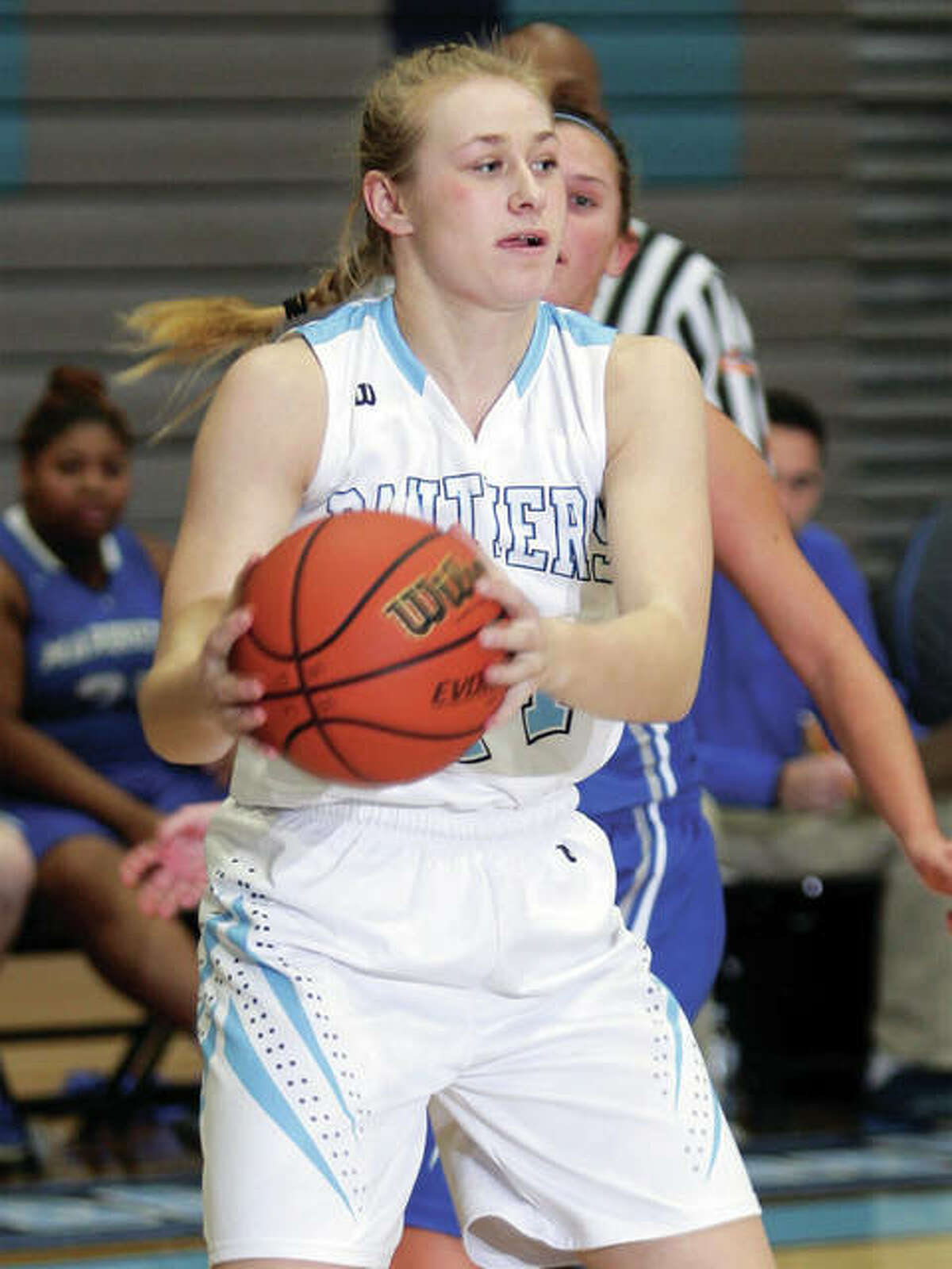 Jersey's Lauren Brown, shown looking for a teammate after pulling in a rebound during a Dec. 6 game against Marquette Catholic in Jerseyville, and the Panthers were on the road Tuesday and picked up victory No. 18 at Mascoutah.
