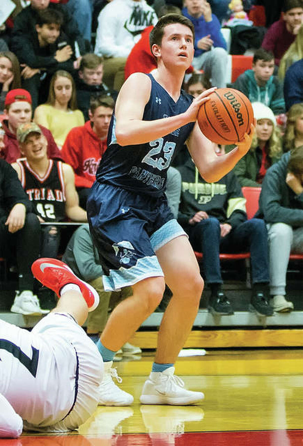 Jersey's Cody Gibson looks to the basket after a Triad defender falls to the floor during a Panthers win Jan. 5 in Troy. The Panthers were back home Tuesday night at Havens Gym in Jerseyville and fell to Mount Vernon in overtime.
