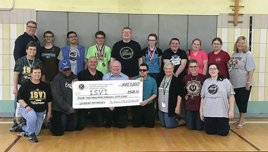 Members of the Jacksonville Kiwanis Club present students and faculty of the Illinois School for the Visually Impaired with a check for $4,468. It represents money raised by the club's recent 0.5k event. Next year's 0.5k will be April 7. Photo: Photo Provided