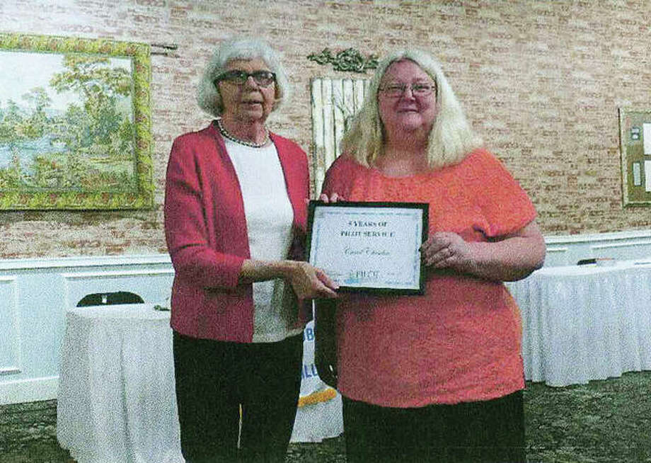 Pilot Club honored Carol Cheseboro (rght) with a certificate April 26 to recognize her five years of service to Pilot. Club President Patty Osborne presented the recognition. Photo: Photo Provided