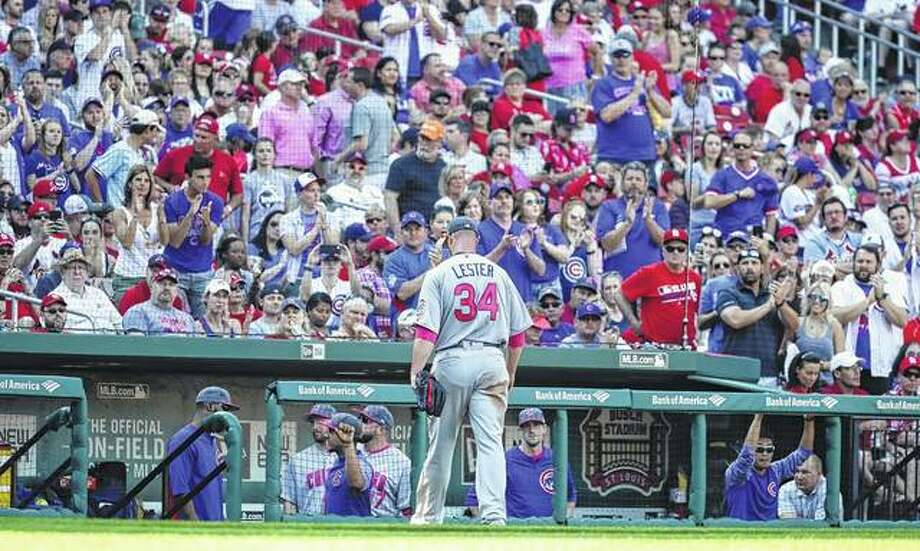 Chicago Cubs starting pitcher Jon Lester (34) exits the game to a standing ovation from Cubs fans during the sixth inning of a baseball game against the St. Louis Cardinals Saturday in St. Louis.