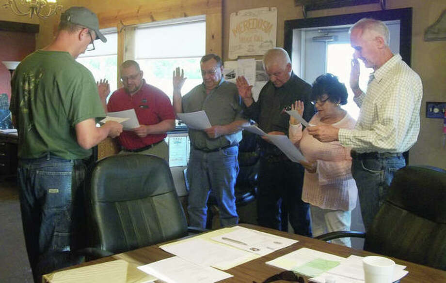 New Meredosia Village President David Werries (from left) swears in trustees Kenny Scott, Ernie Gregory and John Petri, Village Clerk Patricia Engelbrecht and Trustee Steve Hall. Photo: Shirley Bilyeu | Journal-Courier