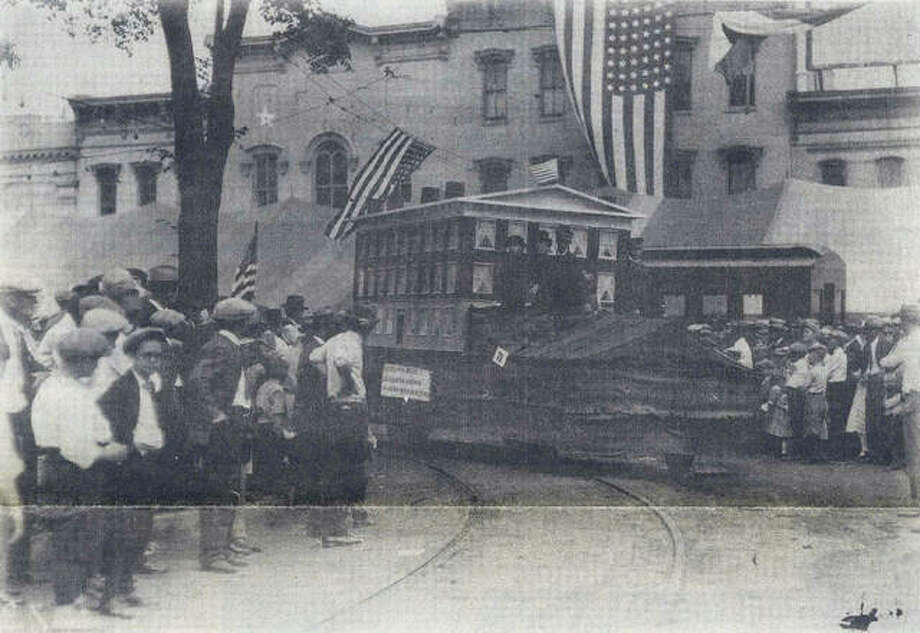The Illinois School for the Deaf float in Jacksonville's centennial parade in 1925. Thousands of people crowded the public square, where this picture was taken, and downtown streets to watch the parade and to see William Jennings Bryan, the famous orator and statesman who once lived in Jacksonville. Photo: Photo Provided By Jacksonville Public Library