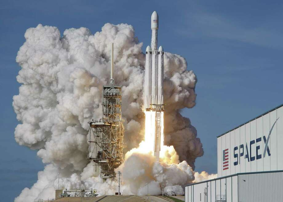 A Falcon 9 SpaceX heavy rocket lifts off from pad 39A at the Kennedy Space Center in Cape Canaveral, Fla., Tuesday, Feb. 6, 2018. The Falcon Heavy, has three first-stage boosters, strapped together with 27 engines in all. (AP Photo/John Raoux) Photo: John Raoux, STF / Copyright 2018 The Associated Press. All rights reserved.